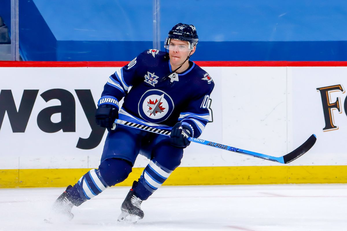 Paul Stastny #25 of the Winnipeg Jets takes part in the pre-game warm up sporting a special jersey to commemorate his milestone 1000 NHL games played prior to NHL action against the Vancouver Canucks at the Bell MTS Place on May 11, 2021 in Winnipeg, Manitoba, Canada.
