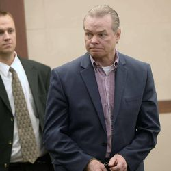 Douglas Anderson Lovell, 57, convicted of aggravated murder for kidnapping and killing 39-year-old Joyce Yost in 1985 to keep her from testifying against him in a rape case enters the courtroom in Ogden, Utah, on Tuesday, March 31, 2015.  Jurors continued to deliberate Wednesday whether the Clearfield man should be sentenced to life in prison or return to death row for the 1985 murder of Joyce Yost.