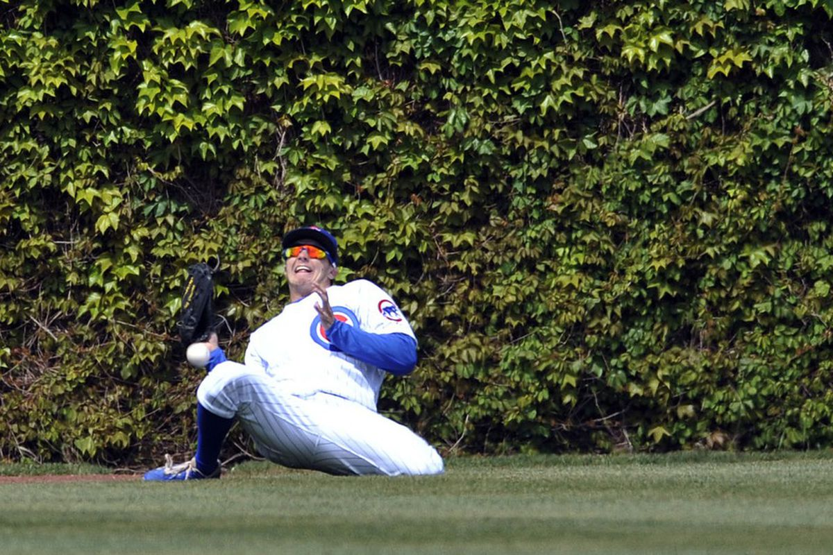 Chicago, IL, USA; Chicago Cubs center fielder Tony Campana loses the ball in the sun in the seventh inning against the Cincinnati Reds at Wrigley Field.  Credit: David Banks-US PRESSWIRE