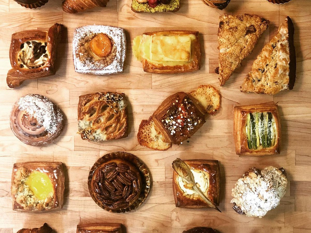 A variety of pastries on a wooden butcherblock counter