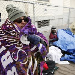 Brandy Lytle, who is homeless, tries to stay warm in downtown Salt Lake City on Thursday, Dec. 8, 2016.