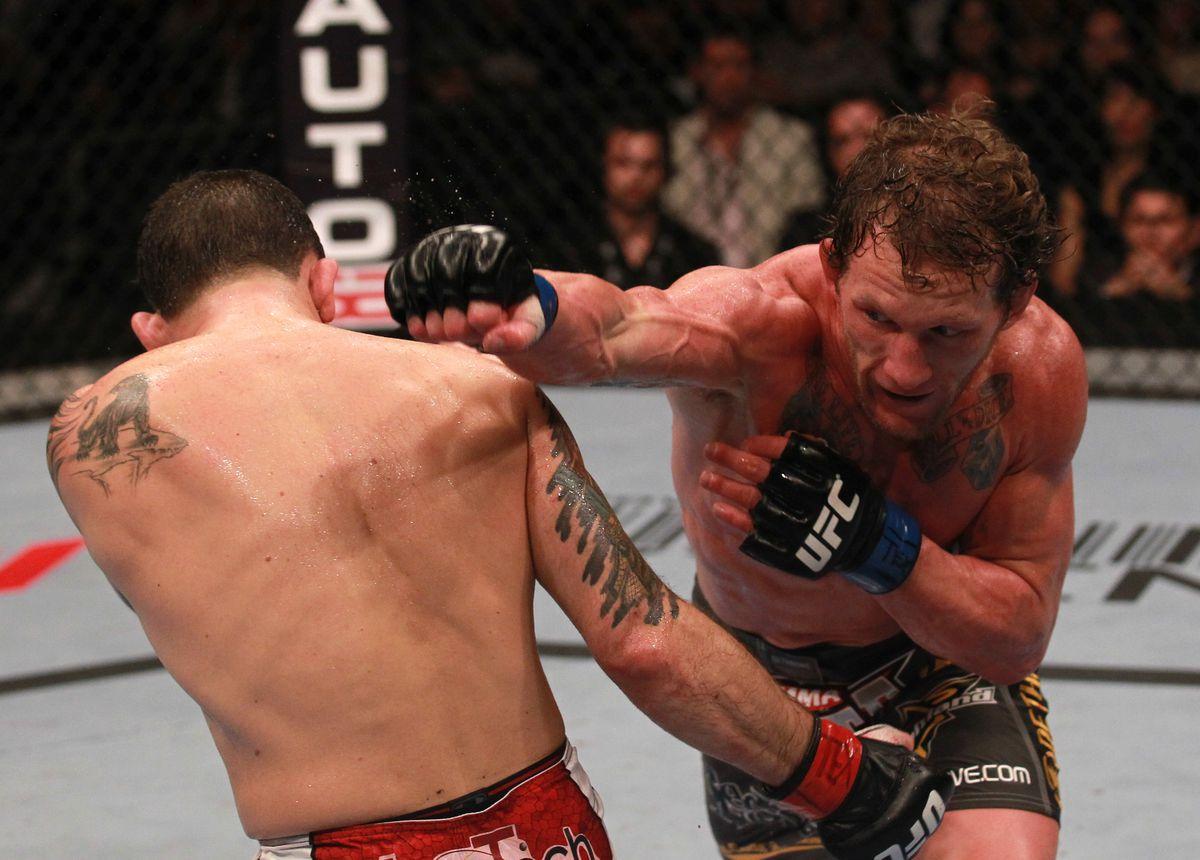 Gray Maynard punches Frankie Edgar at UFC 136 in Texas.