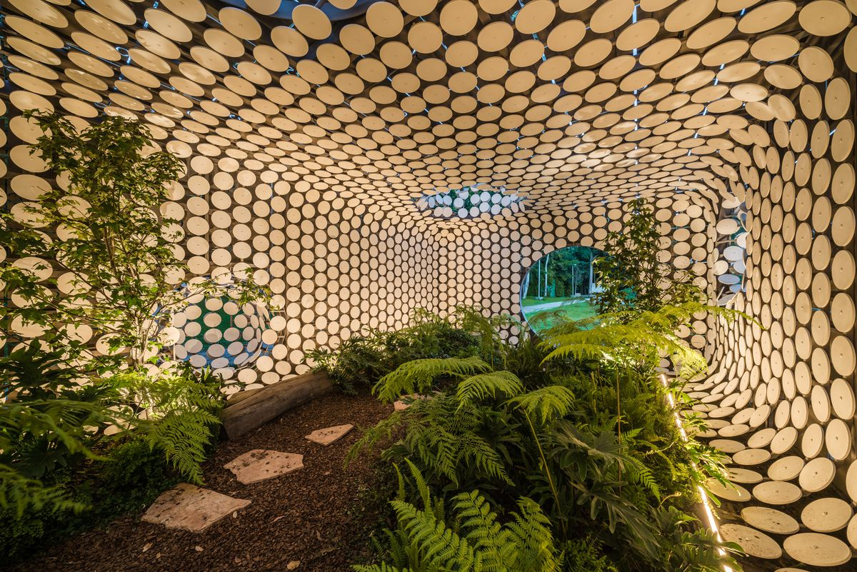 Interior of pavilion with plants everywhere.