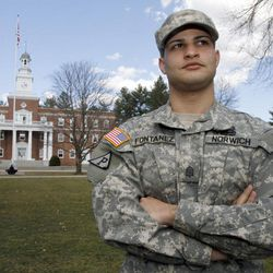 """FILE - In this March 21, 2012, file photo, Norwich University cadet Joshua Fontanez, who laid the groundwork for the school's Lesbian, Gay, Bisexual, Transgender, Questioning and Allies Club, stands on the parade ground in Northfield, Vt.  Norwich University President Richard Schneider said Tuesday, April 10, 2012, that the administration should have had more oversight of the activities of the school's Lesbian, Gay, Bisexual, Transgender, Questioning and Allies club and focused more on education and ensuring that gay and lesbian students feel comfortable, supported and safe at college, after hundreds of alumni were upset the school hosted a gay pride week that featured events such as a """"condom Olympics"""" and a """"queer prom."""""""