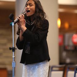 Faith Nandkeshwar, 14, of Layton, sings the national anthem during tryouts at EnergySolutions Arena on Friday, Oct. 4, 2013. The winners will perform the anthem prior to each Utah Jazz home game during the 2013-2014 season.