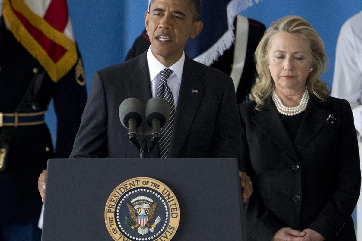 FILE - In this Sept. 14, 2012 file photo, President Barack Obama, accompanied by Secretary of State Hillary Rodham Clinton, speaks during a Transfer of Remains Ceremony at Andrews Air Force Base, Md., marking the return to the United States of the remains