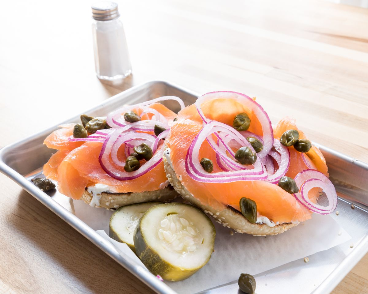 Sesame seed bagel with capers, cream cheese, red onions, and lox