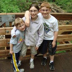 Sara Flash, 13, flanked by her brothers, Daniel, 5, and Adam, 10. Sara has battled Non-Hodgkin's lymphoma. But when one child is sick, the whole family struggles, experts say. They live near Seattle, Wash.