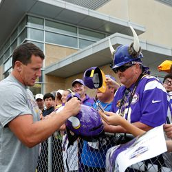 Jul 27, 2013; Mankato, MN, USA; Minnesota Vikings linebacker Chad Greenway (52) signs autographs for fan Bill Keech at training camp at Blakeslee Fields. Mandatory Credit: Bruce Kluckhohn-USA TODAY Sports
