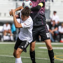 Emery Spartan Carter Huntington (22) and Morgan Trojan Cole Terry (17) fight for the ball during a 3A semifinal game of soccer between the Emery Spartans and Morgan Trojansat Juan Diego Catholic High School in Draper on Monday, May 17, 2021.