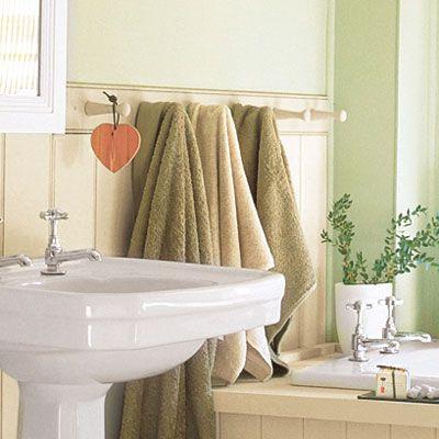 Bathroom towel rack next to sink and tub.