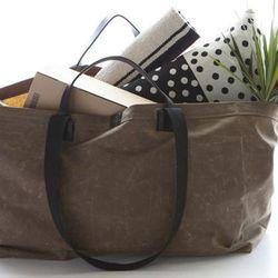 "Marie Turnor bag, <a href=""http://shop.marieturnor.com/products/the-idea-bag-dark-tan""target=""_blank"">$215</a>."