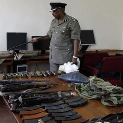 Kenya Police spokesman View Eric Kimathi displays seized arms and  ammunition to journalists in Nairobi, Kenya, Friday, Sep. 14, 2012. Kenyan police say they have arrested two people suspected to have links with an al-Qaida-linked Somali militant group that was in the last stages of planning a major terrorist attack. Boniface Mwaniki , the head of Kenya's Anti-Terrorism Police Unit, said Friday that police found four suicide vests, a cache of weapons and 12 grenades. Al-Shabab has vowed to carry out terror attacks in Kenya in retaliation against the country for sending troops into Somalia.