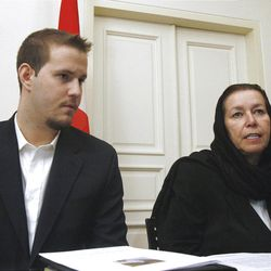 In this Dec. 22, 2007 file photo, Christine Levinson, right, the wife of missing former FBI agent Robert Levinson, and her son Daniel take part in news conference at the Swiss Embassy in Tehran. The US has proof that ex-FBI agent Robert Levinson is alive, four years after vanishing in Iran.