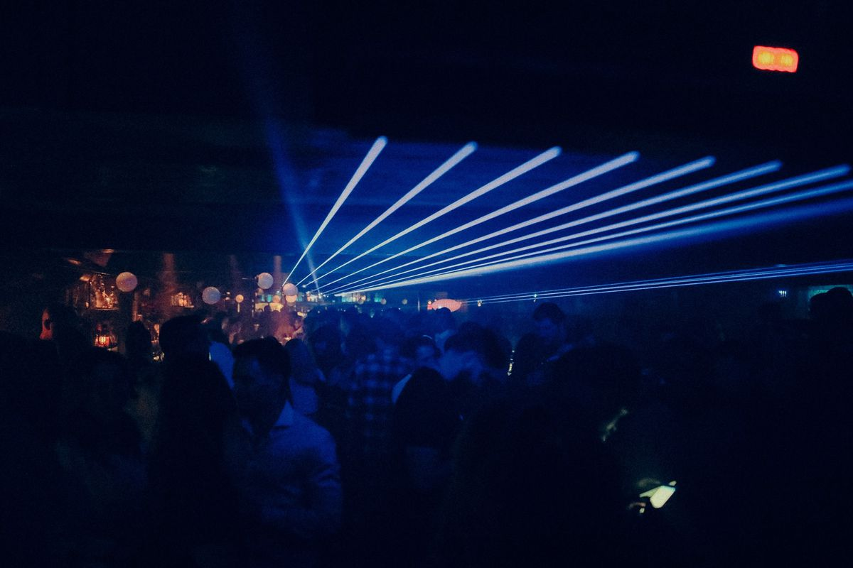 people in club with blue lights