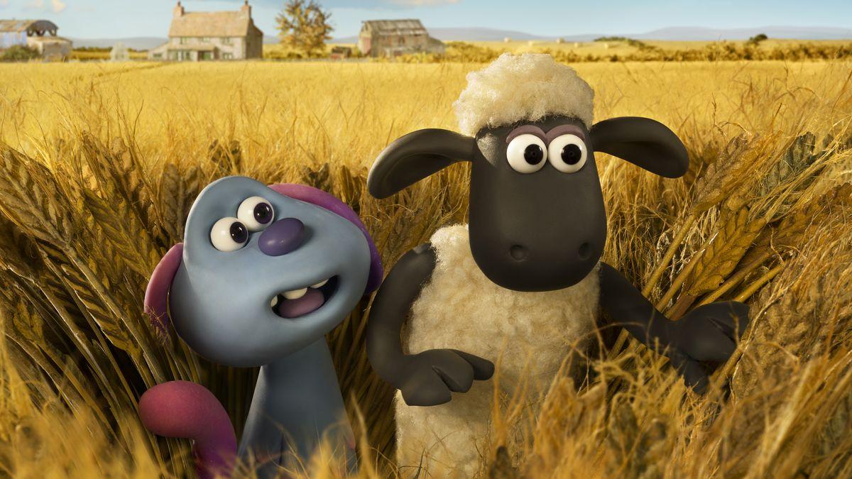 A blue alien and a sheep wade through a field.