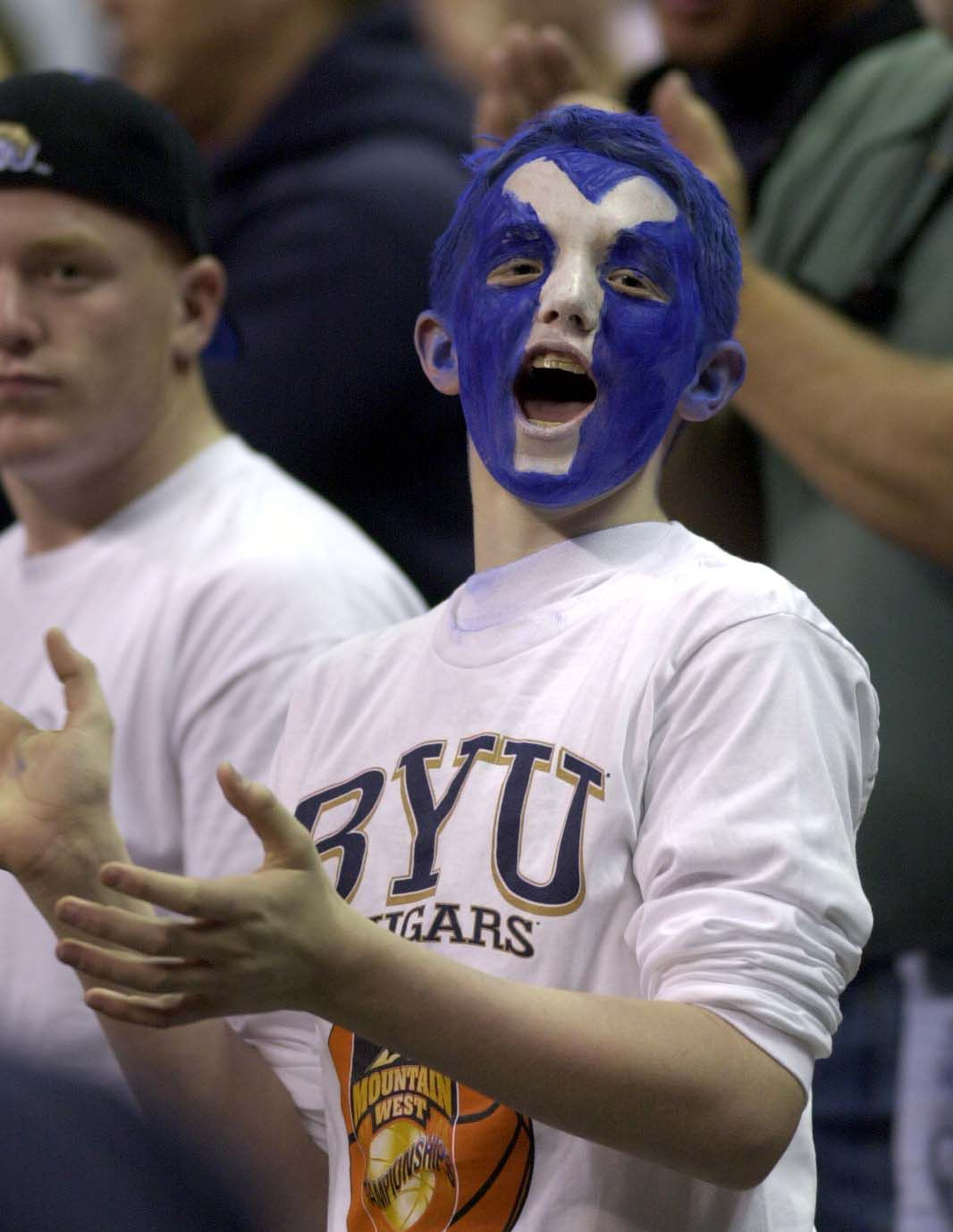 BYU fan Brett Dodge cheers his team during game against New Mexico in the MWC Tournament championship game.