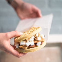 """Campfire """"L'eggo my Eggo"""" sandwich, with milk chocolate, graham cracker, and torched marshmallow"""