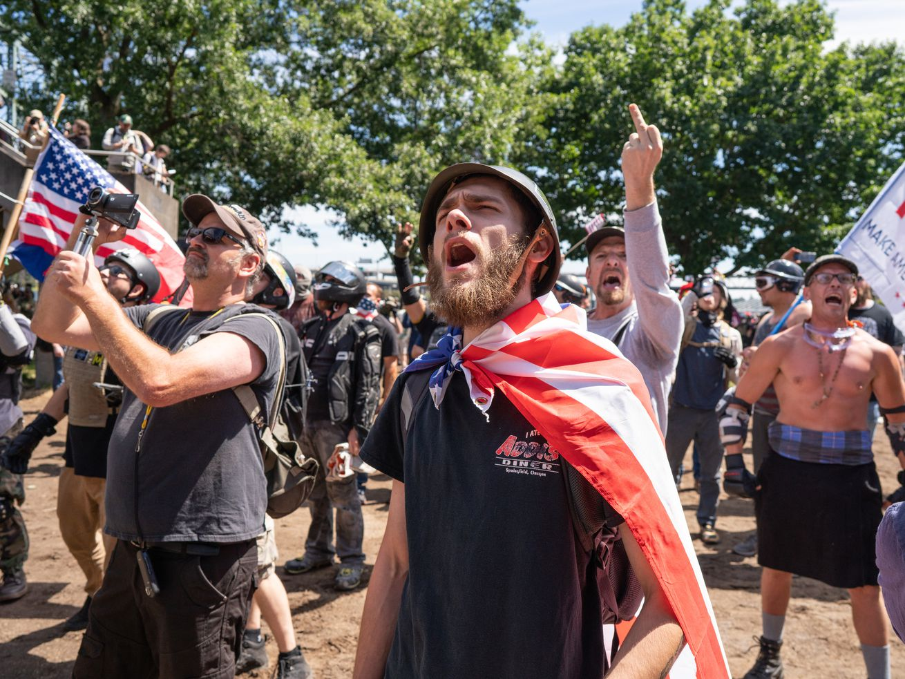 Far-right protesters jeer at members of Antifa during protests organized by the far-right group the Proud Boys.