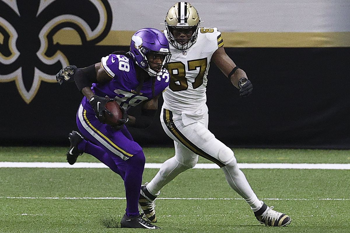 Harrison Hand #38 of the Minnesota Vikings intercepts a pass intended for Jared Cook #87 of the New Orleans Saints during the second quarter at Mercedes-Benz Superdome on December 25, 2020 in New Orleans, Louisiana.