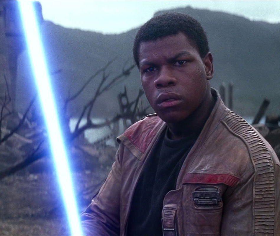 finn holding a lightsaber in star wars: the force awakens
