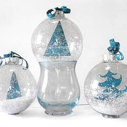 Create a snowy winterscape inside a glass ornament with the help of glitter.