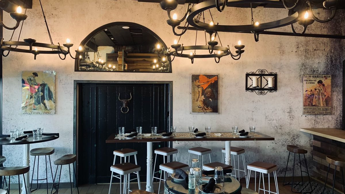 Art depicting bullfighters covers the walls at Bodegon's new location on Barracks Row