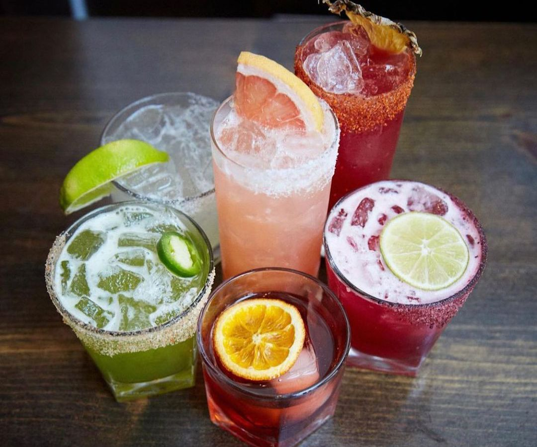 Mix of colorful refreshing cocktails in glasses