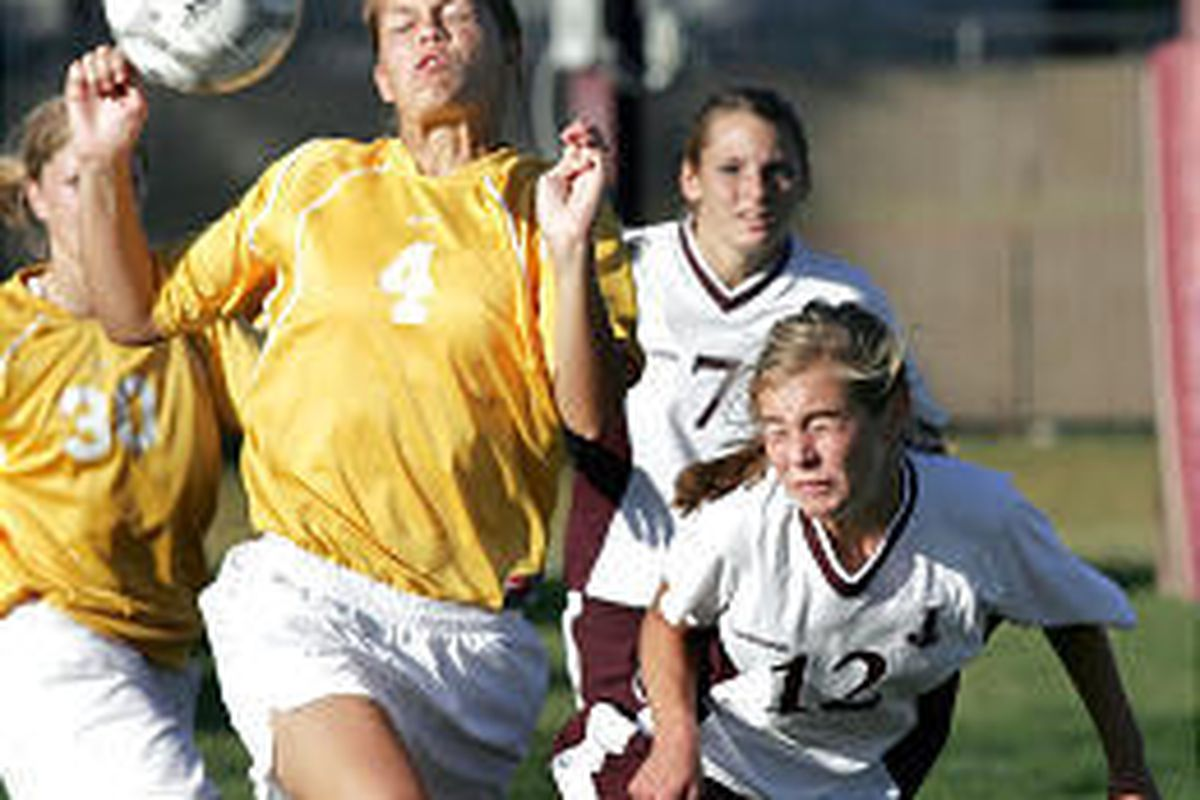 Davis' Brittany Taylor (4) and Jordan's Amber Nordhagen fight for the ball during the Darts' 1-0 victory.