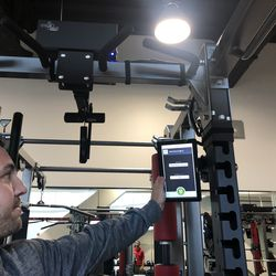 Head Athletic Trainer <strong>Matt Koscs</strong> shows off the center's digital addition to their weight lifts. Each station has a touchscreen tablet that shows each student-athlete's personalized workout and cameras to tape athletes and show their technique. It's used by a handful of other programs, including Kansas basketball.