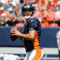 Broncos QB Joe Flacco eyes his passing target.