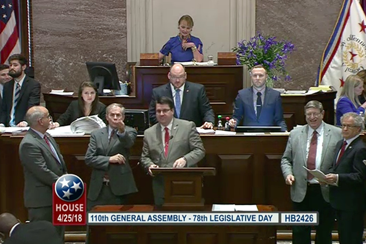 Rep. Eddie Smith of Knoxville stands at the front podium of the Tennessee House of Representatives on April 25, the last day of the 2018 legislative session, as the chamber's education leaders press for a bill to hold teachers harmless for this year's TNReady scores.