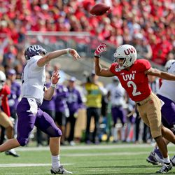Reggie Pearson returned to action in the second half, and here gets pressure on the NU QB.