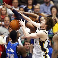 Utah Jazz guard Gordon Hayward (20) and Dallas Mavericks guard Vince Carter (25) battle for a rebound as the Utah Jazz and the Dallas Mavericks play Monday, April 16, 2012 in Salt Lake City.