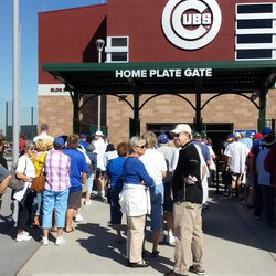 Fans wait to get into Cubs Park on its first day