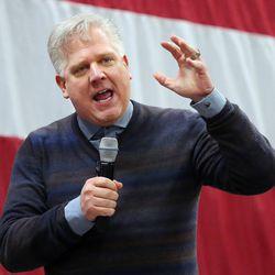 Talk show host Glenn Beck speaks on behalf of Sen. Mike Lee, R-Utah, at a rally in Draper at the American Preparatory Academy Saturday, March 19, 2016.