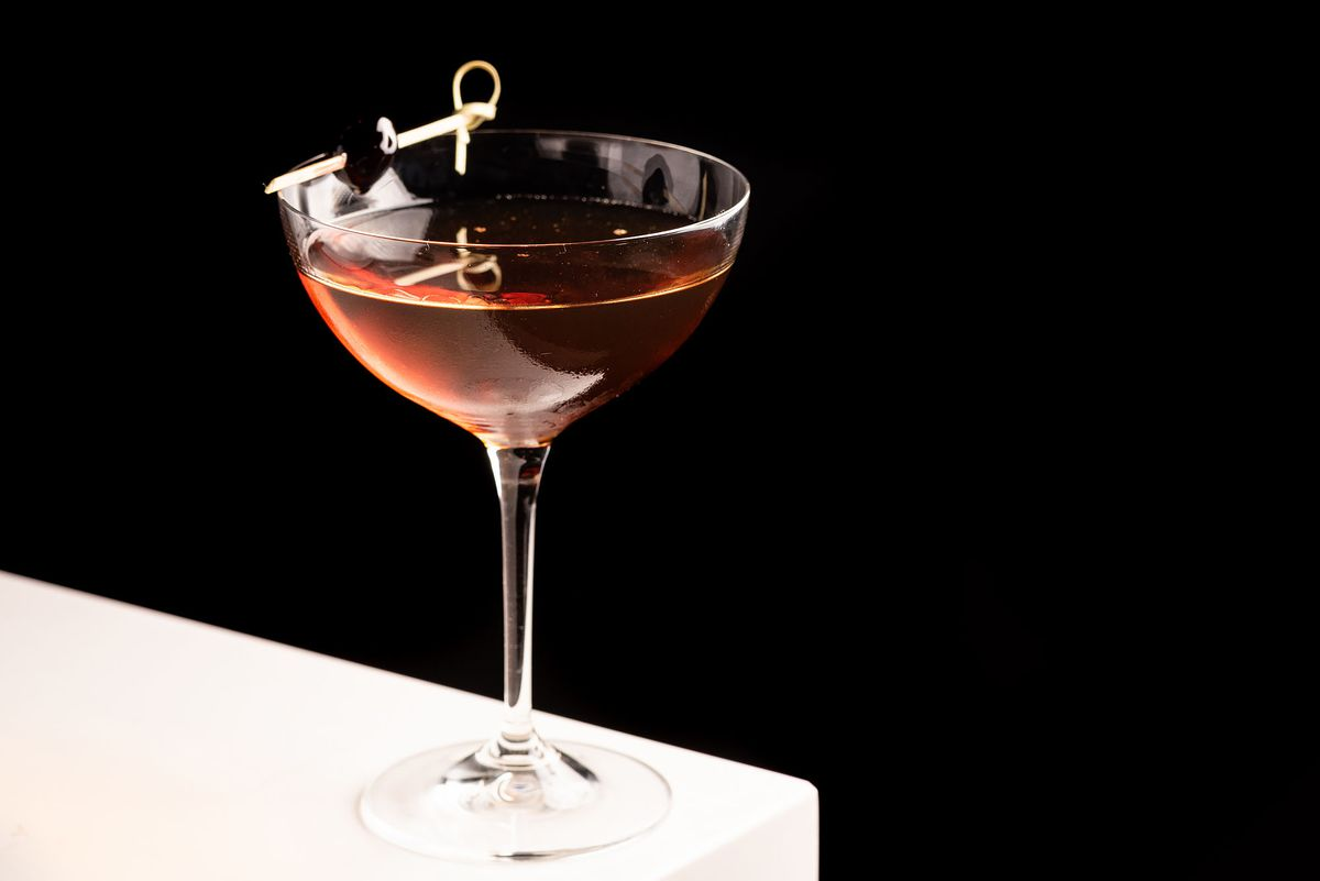 A classic Manhattan cocktail in a coup glass.