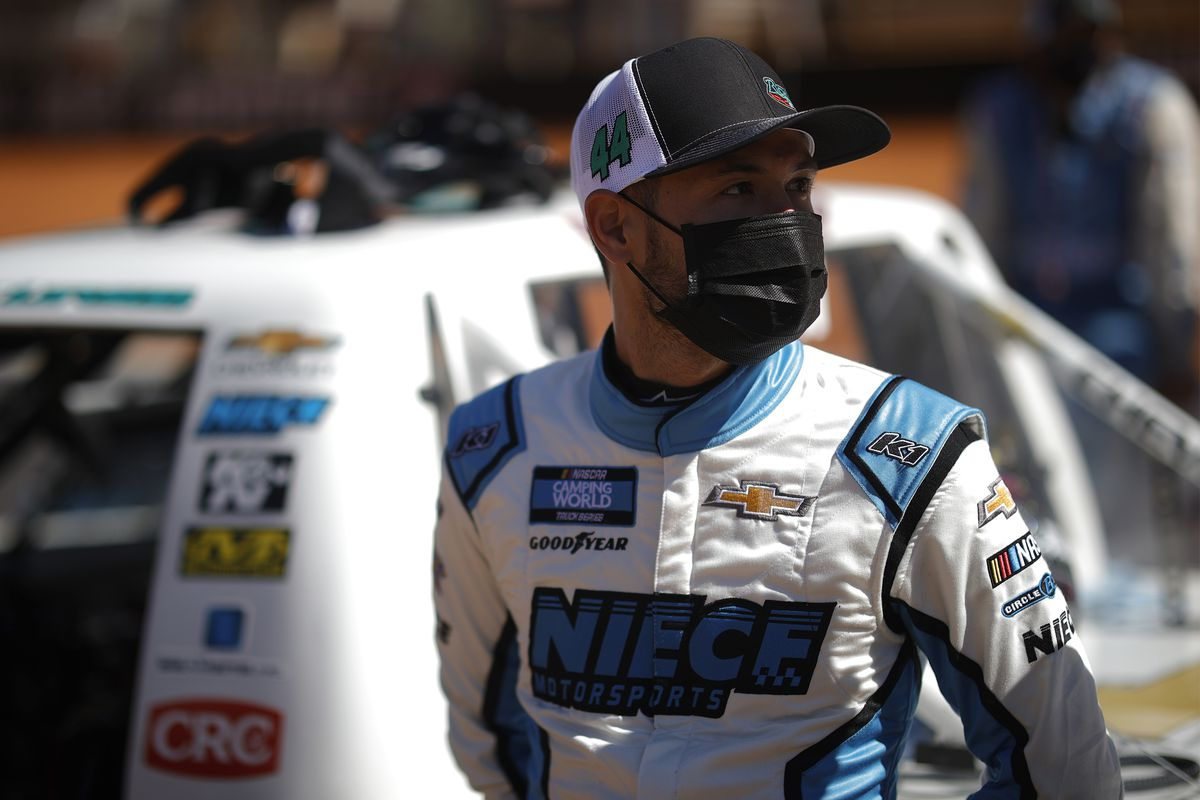 Kyle Larson, driver of the #44 Rich Mar Florist/Circle B Chevrolet, waits on the grid prior to the NASCAR Camping World Truck Series Pinty's Truck Race on Dirt at Bristol Motor Speedway on March 29, 2021 in Bristol, Tennessee.