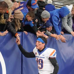 Boise State quarterback Hank Bachmeier celebrates the victory against BYU with fans at LaVell Edwards Stadium in Provo on Saturday, Oct. 9, 2021.