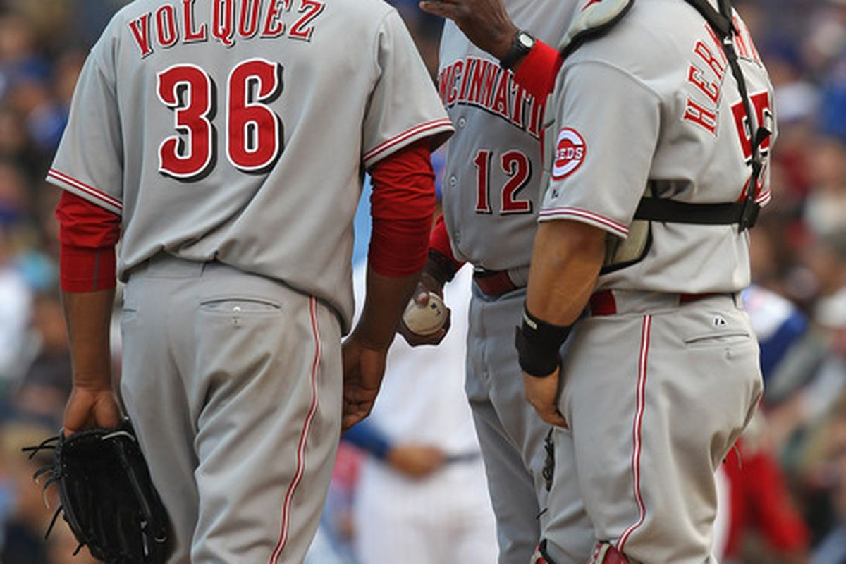 Volquez tried to hand the ball to Ramon Hernandez, but it ended up wildly in the hand of Dusty Baker.  His control is... not good. (Photo by Jonathan Daniel/Getty Images)