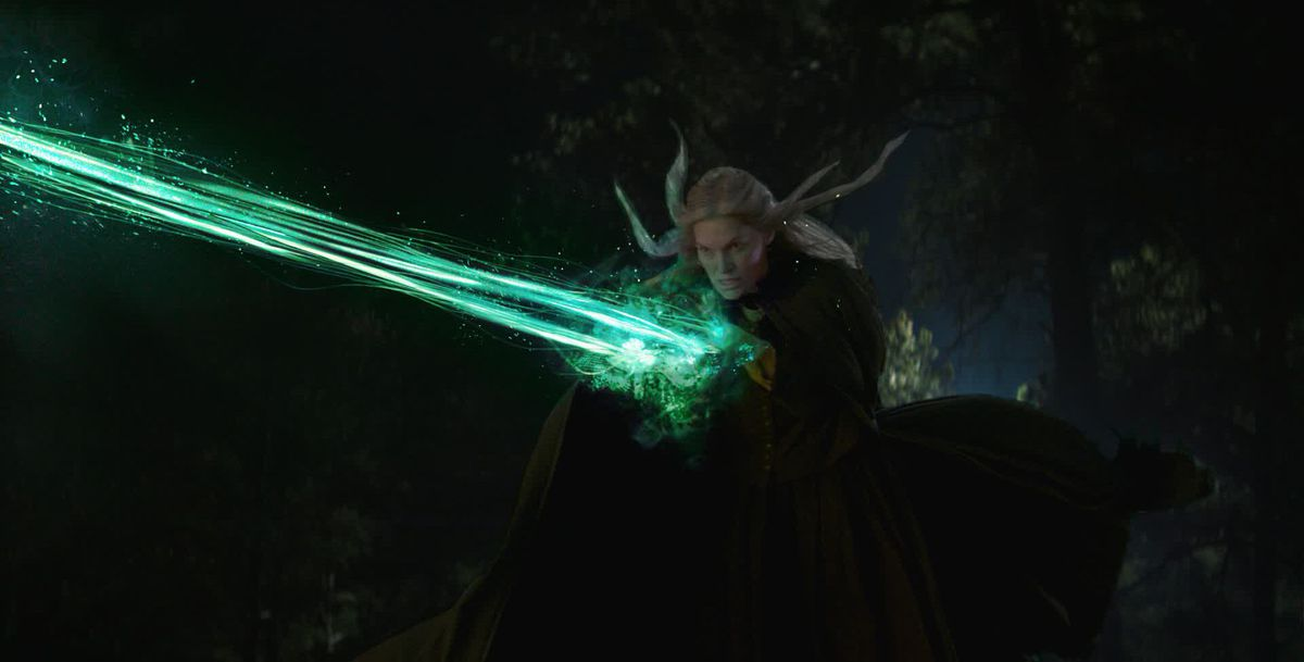 A witch attacks Agatha with a bolt of green magic in early VFX concept art for WandaVision