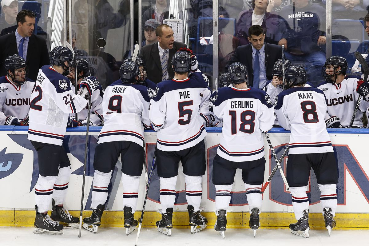 Mike Souza (far left) was an associate head coach at UConn the past two seasons.