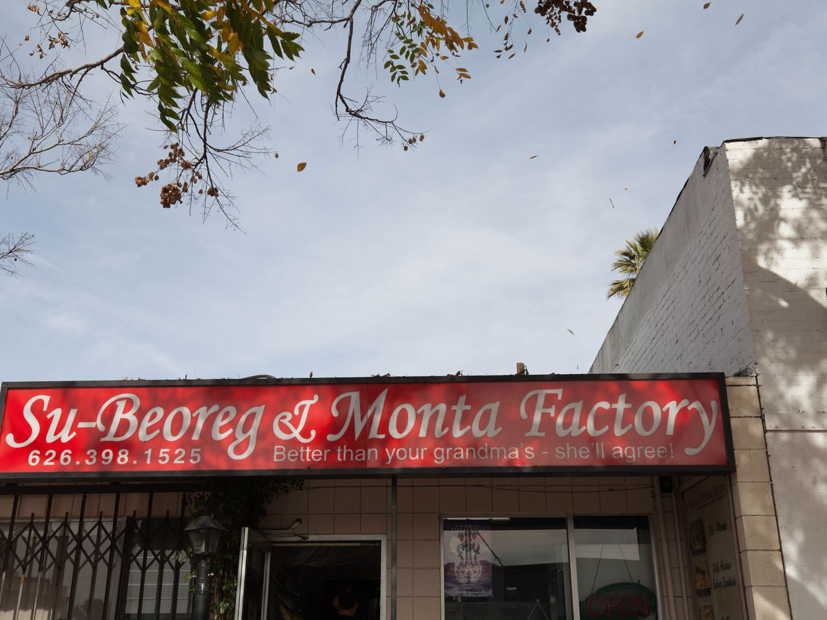 The red and white sign outside the monta shop.