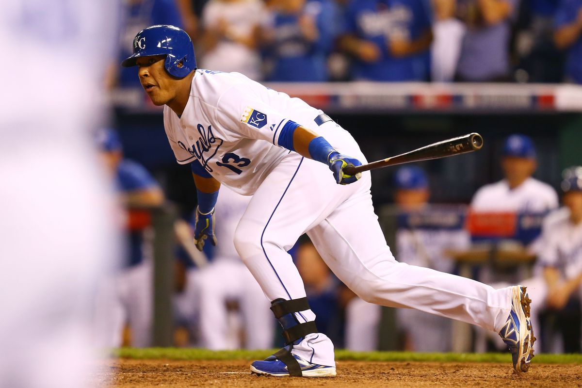 Salvador Perez watches a groundball roll past Josh Donaldson after hitting a pitch he never should have swung at or been able to reach.