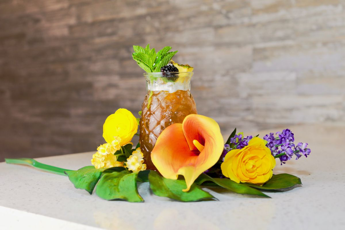 A cocktail surrounded by flowers