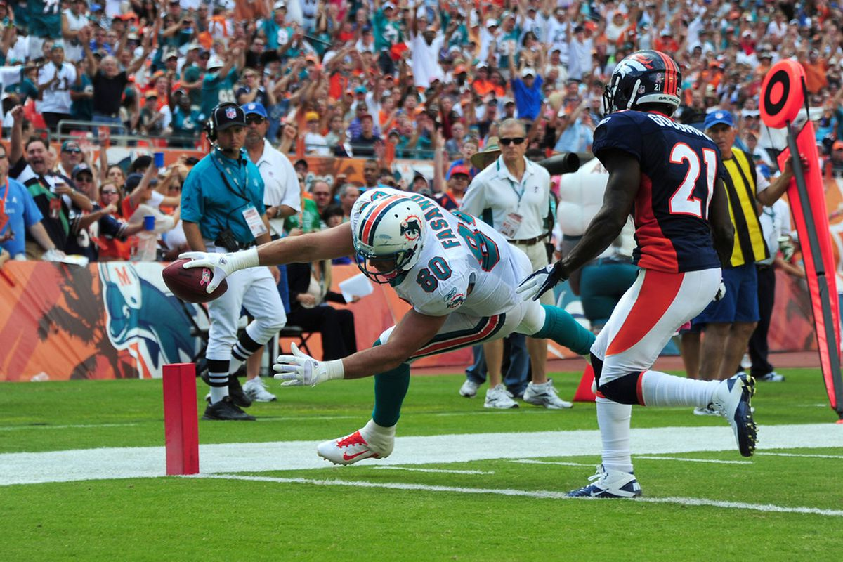 MIAMI GARDENS, FL - OCTOBER 23: Anthony Fasano #80 of the Miami Dolphins scores a second half touchdown against the Denver Broncos at Sun Life Stadium on October 23, 2011 in Miami Gardens, Florida. (Photo by Scott Cunningham/Getty Images)