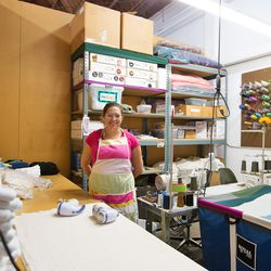 "Inside the workshop, Mirna is busy shaving or ""polishing"" sweatpants."