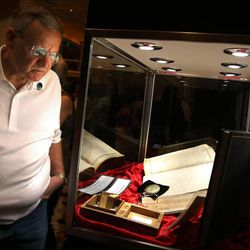 Ronald Emerson of Lafayette, La., looks at a display containing a pocket watch and bibles belonging to Joseph Smith at the Independence Through History Museum in the Grand America in Salt Lake City on Friday, July 5, 2013.