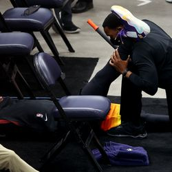 Utah Jazz guard Donovan Mitchell (45) has his right leg rolled out off court as the Utah Jazz and the Memphis Grizzlies play in game 5 at Vivint Arena in Salt Lake City on Wednesday, June 2, 2021.