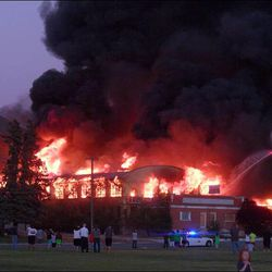 A fire burns at Baron Woolen Mills in Brigham City, Sunday, June 29, 2014.